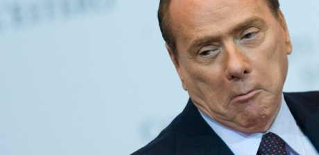 Italy Prime Minister Silvio Berlusconi makes a face as he attends a meeting in Rome